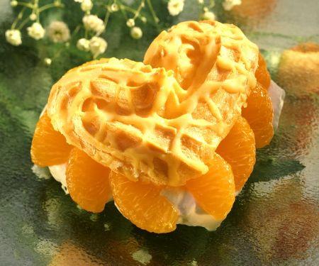 Brandteigherzen mit Mandarinen und Sahne