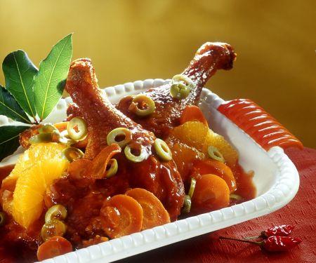 Entenkeulen mit Orangen und Oliven