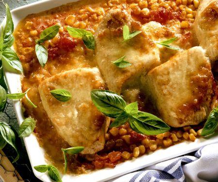 Gratinierte Putenschnitzel mit Mais und Tomaten