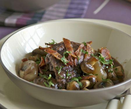 Hahn in Weinsoße mit Kartoffeln (Coq au vin)