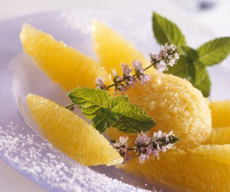 Mangoeis mit Orangenfilets