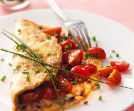 Omelette mit Pilzen und Tomaten