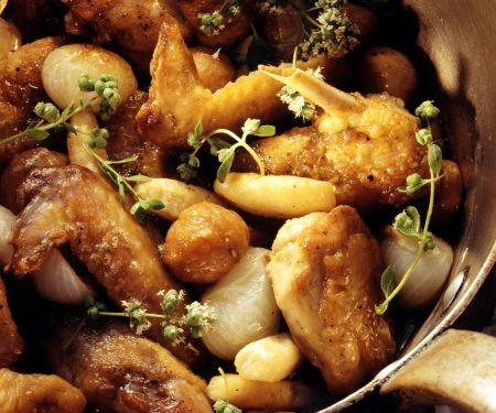 Perlhuhn mit kleinen Zwiebelchen und Maroni