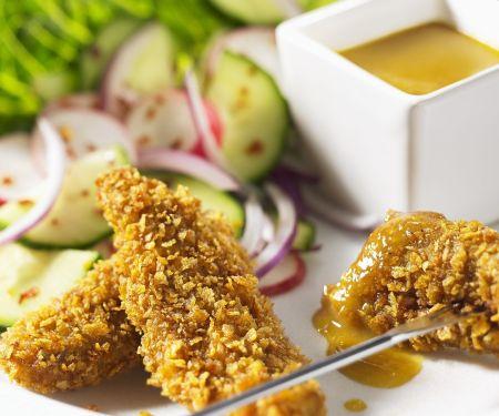 Rinderfilet in nussiger Kruste mit Currysoße und buntem Salat