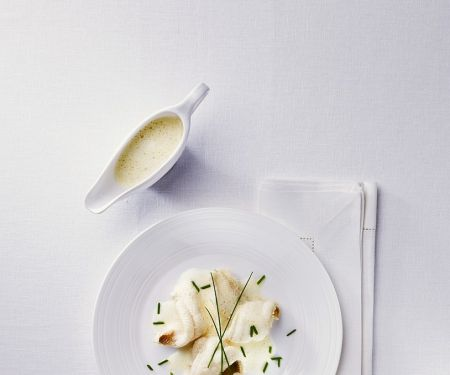 Seezungenröllchen mit Weißweinsauce