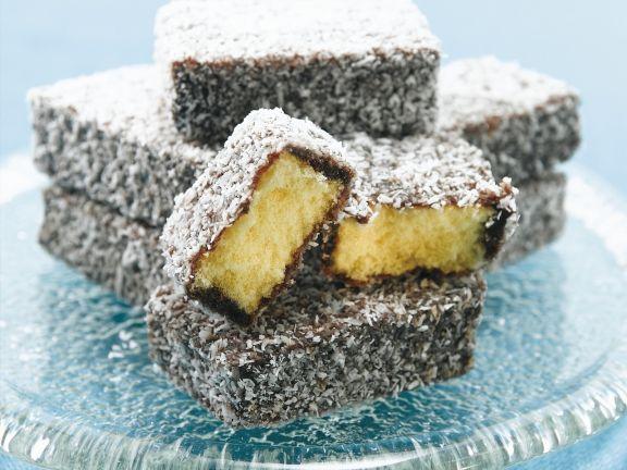 Biskuitkuchen mit Kokos-Schoko-Hülle (Lamingtons)