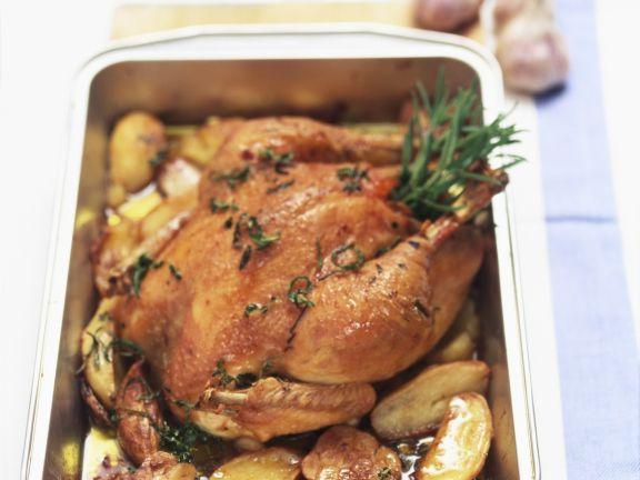 Brathähnchen mit Knoblauch, Rosmarin und Kartoffeln