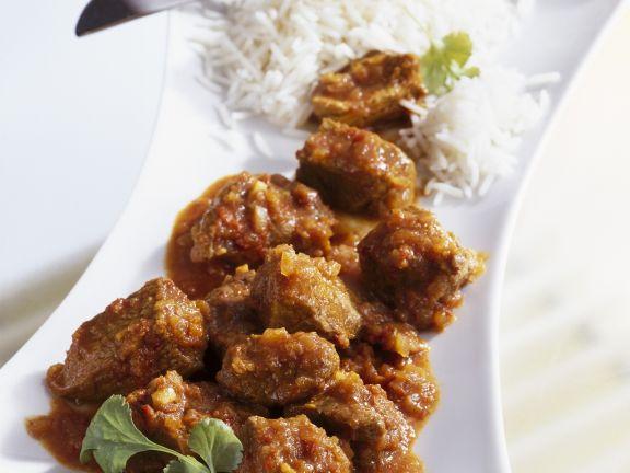 Curry mit Lamm dazu Reis