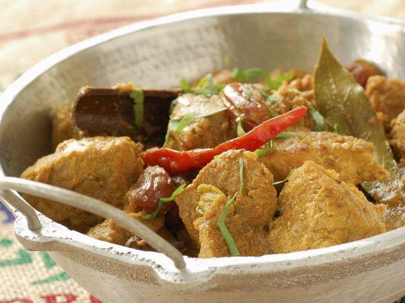 Curry mit Schweinefleisch und Sultaninen