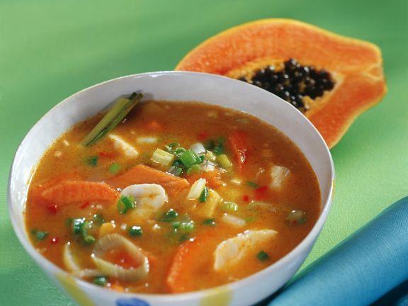 Currysuppe mit Papaya, Ingwer und Fisch