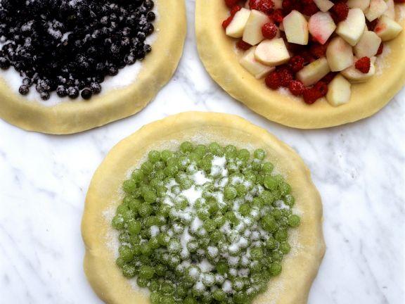 Drei verschiedene Beerenpizzen