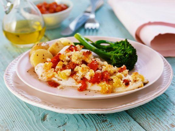 Fisch mit Bröseln und Gemüse