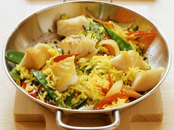 Fisch-Reis-Pfanne mit Zuckerschoten und Paprika