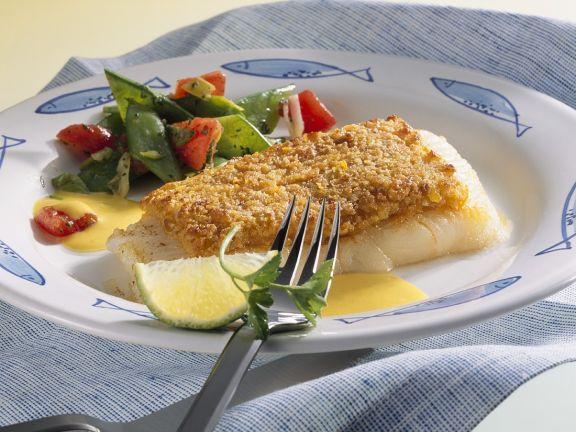 Fisch unter der Gemüsehaube