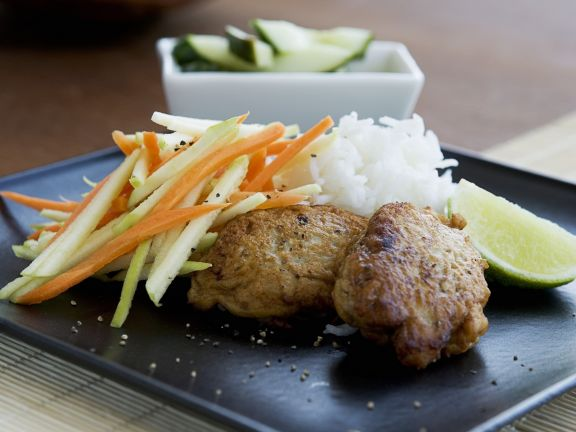 Fischbuletten mit Gemüse und Reis