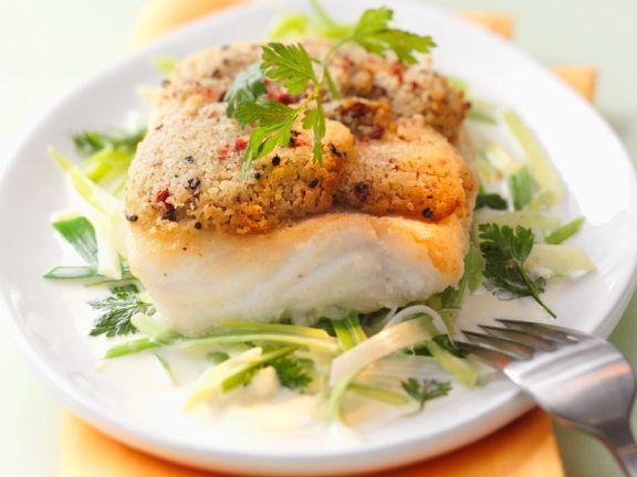 Fischfilet mit Nuss-Kräuterkruste und Lauchgemüse