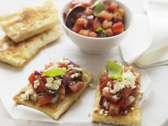 Fladenbrot mit Feta und marinierten Tomaten