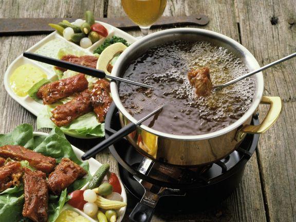 fondue mit spareribs rezept eat smarter. Black Bedroom Furniture Sets. Home Design Ideas