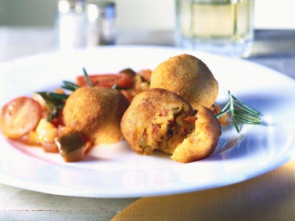 Frittierte Kartoffel-Speckklöße