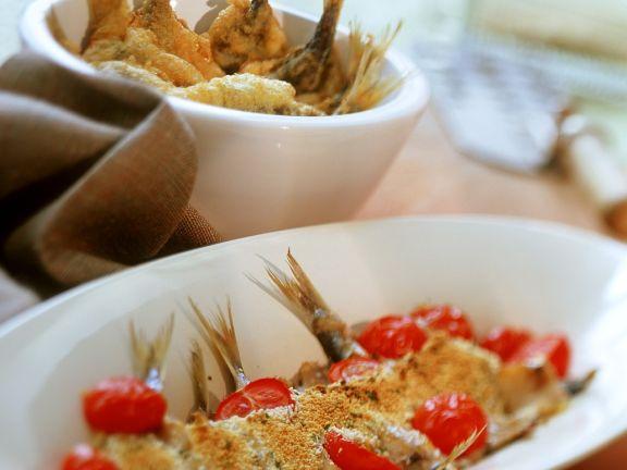 Frittierte und überbackene Sardellen