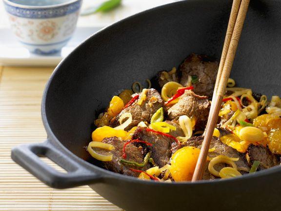 Fruchtige Rindfleischpfanne mit Mandarine