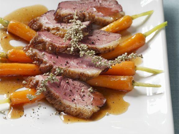 Gänsebrust auf Karotten