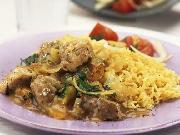 Geschnetzeltes vom Schwein mit Zwiebel-Aprikosen-Soße und Reis