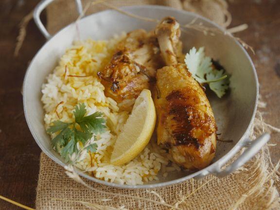 Hähnchenschlegel mit gelbem Reis