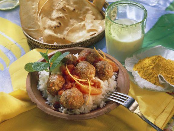 Indische Hackbällchen mit Orangen-Tomatensoße und Reis