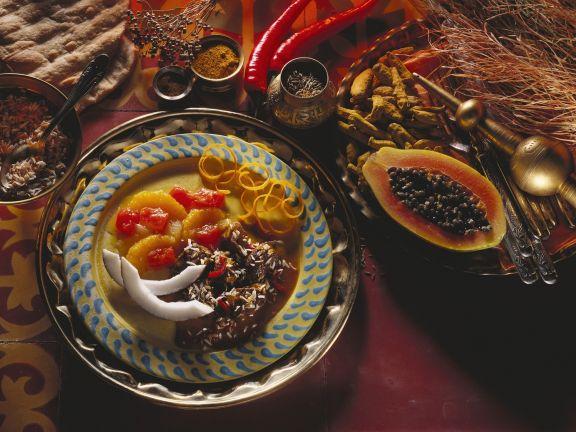 Indischer Enteneintopf mit Chutney aus Papaya