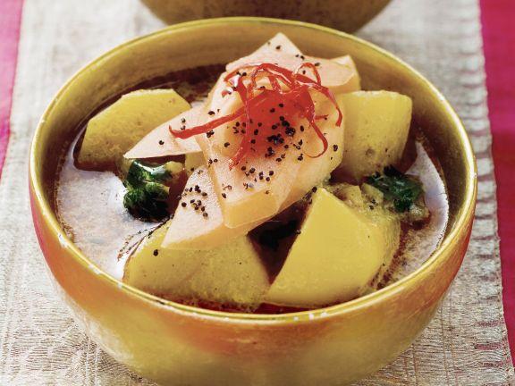 Indisches Kartoffelcurry mit Mango und Mohn