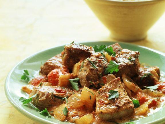Ingwer-Tomaten-Geschnetzeltes mit Joghurt-Curry-Sauce
