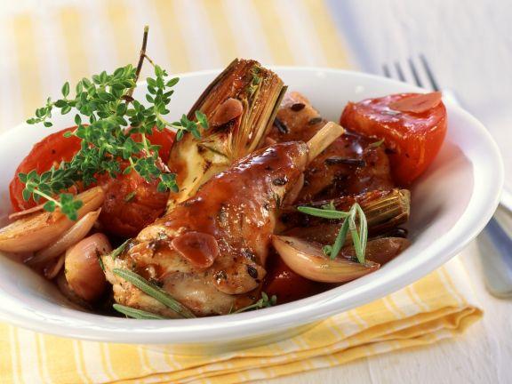 Kaninchen in Artischocken, Tomaten und Schalotten