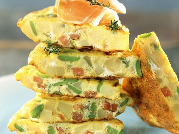 Kartoffel-Tortilla mit Bohnen und Speck