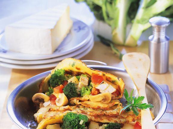 Kräuterpfannkuchen mit Gemüsefüllung gebacken