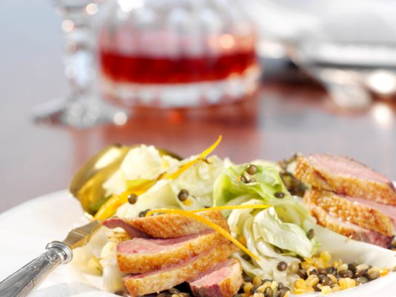 Linsen-Spitzkohl-Gemüse mit Orange zu Entenbrust