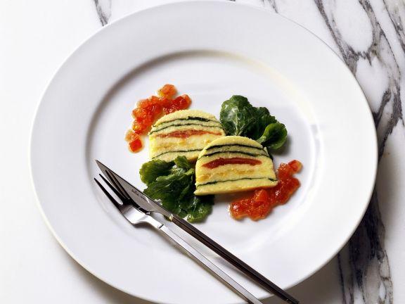 Maisterrine mit Tomate