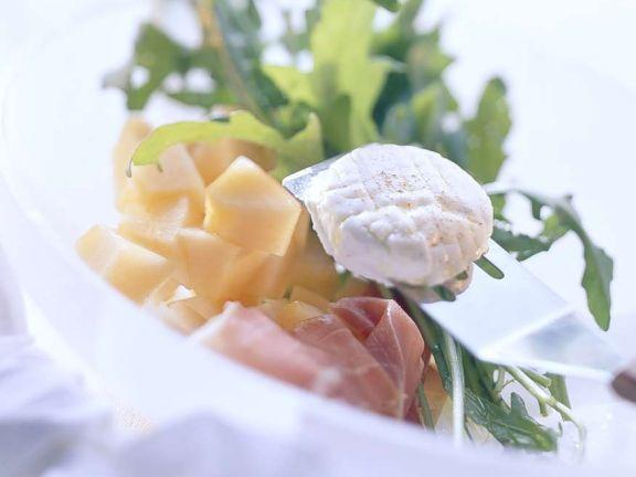 Melone mit Parmaschinken und Käse