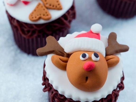 Mit Fondant verzierte Cupcakes