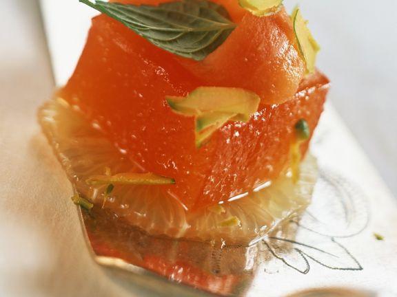 Orangengelee mit Grapefriut und Papaya