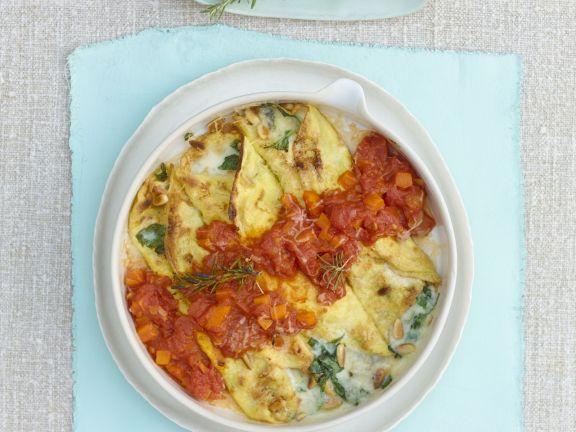 Pikante gefüllte Crêpes mit Gorgonzola, Tomaten und Rosmarin