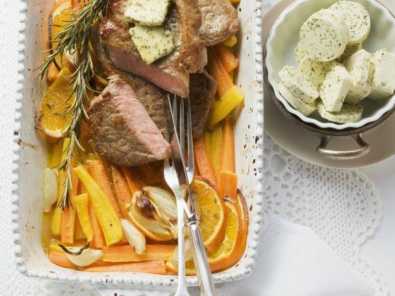 Rindersteak mit Karotten und Kräuterbutter