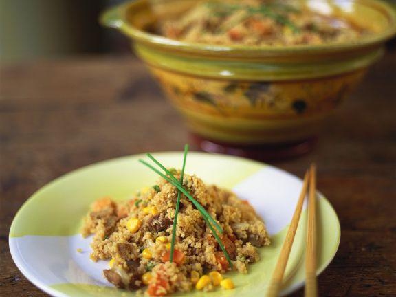 Scheinefleisch und Gemüse, dazu Couscous