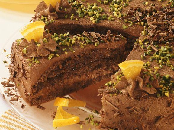 Schokoladentorte mit Pistazien und Orangenstückchen