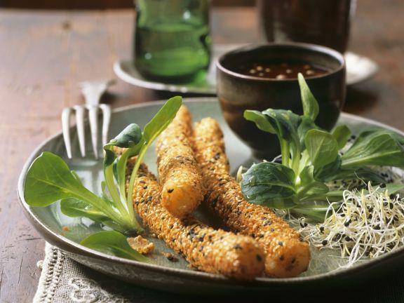 Schwarzwurzeln in Sesampanade mit Rapunzelsalat