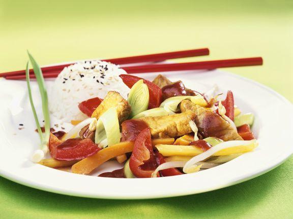 Schweinefleisch-Gemüse-Pfanne mit Reis