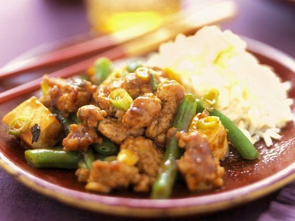 Schweinefleischpfanne mit Tofu und grünen Bohnen