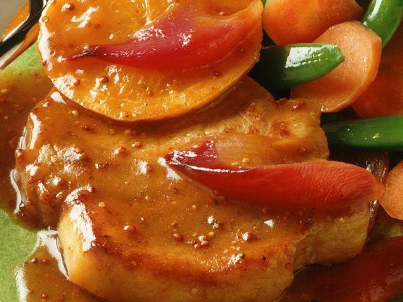 Schweineschnitzel mit Orangensauce