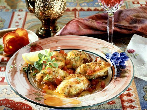 Seeteufel-Schnitzel mit Tomaten