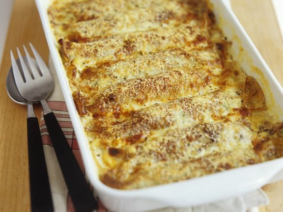 Spnat-Pfannkuchen mit Käsesauce überbacken